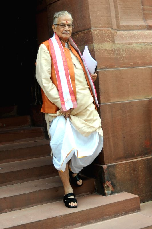 BJP leader and Kanpur MP Murli Manohar Joshi comes out of the Parliament after attending budget session of the house in New Delhi on July 14, 2014. - Murli Manohar Joshi