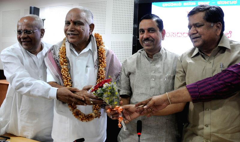 BJP leader and Shimoga MP BS Yeddyurappa being felicitated by party leaders Jagadish Shettar, Pralhad Joshi, and MoS for Civil Aviation G.M. Siddeshwara during a BJP programme after he was appointed . - Pralhad Joshi