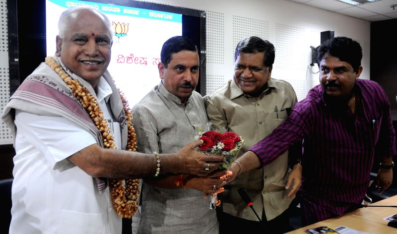 BJP leader and Shimoga MP BS Yeddyurappa being felicitated by party leaders Jagadish Shettar, Pralhad Joshi and R. Ashok during a BJP programme after he was appointed as BJP Vice President in ... - Pralhad Joshi