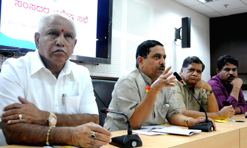 BJP leader and Shimoga MP BS Yeddyurappa with party leaders Pralhad Joshi, Jagadish Shettar and R. Ashok during BJP a programme in Bangalore on Aug 27, 2014. - Pralhad Joshi