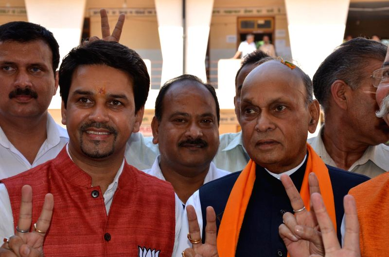 BJP leader Anurag Thakur with Prem Kumar Dhumal after winning Hamirpur Lok Sabha seat in Hamirpur on May 16, 2014. - Prem Kumar Dhumal