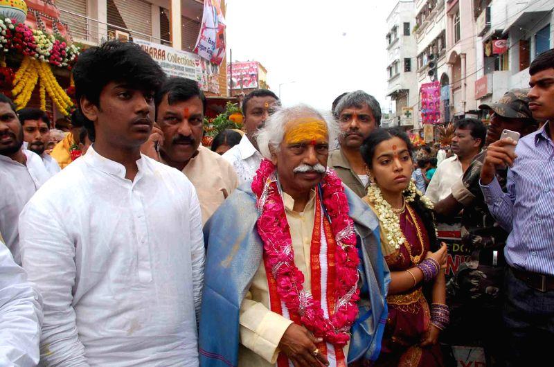 BJP leader Bandaru Dattatreya participates in a Bonalu procession in Hyderabad on July 20, 2014.