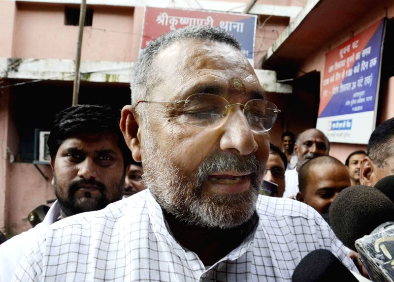 BJP leader Giriraj Singh arrives at S K Puri police station in Patna on July 12, 2014.