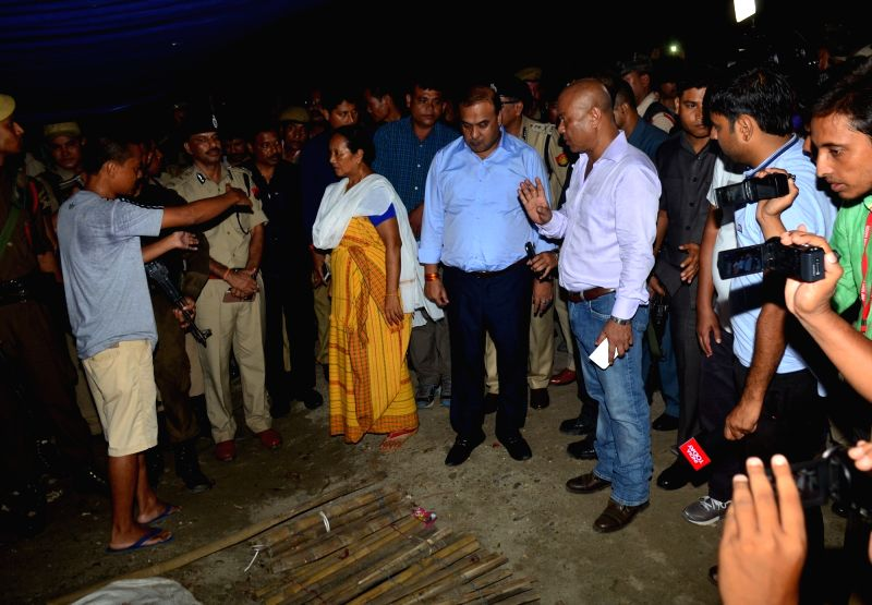 BJP leader Himanta Biswa Sarmah alongwith BPF Chief Hagrama Mahilary arrive at the Kokrajhar terror attack site where 14 people were killed in indiscriminate firing and grenade attack by a ...