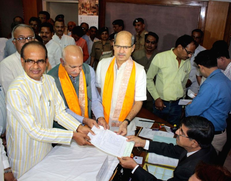 BJP leader MJ Akbar files nomination for elections to Rajya Sabha at Madhya Pradesh Assembly in Bhopal, on May 31, 2016. Also seen Madhya Pradesh Chief Minister Shivraj Singh Chouhan and BJP ... - Shivraj Singh Chouhan