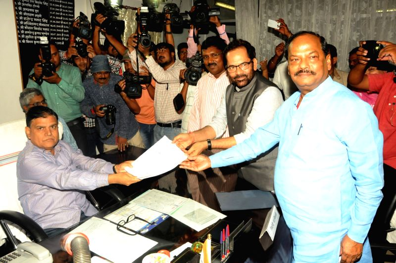 BJP leader Mukhtar Abbas Naqvi files nomination for elections to Rajya Sabha at Jharkhand Assembly in Ranchi, on May 30, 2016. Also seen Jharkhand Chief Minster Raghubar Das.
