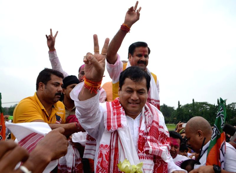 BJP leader Sarbananda Sonowal during a roadshow organised to celebrate party's performance  in the recently concluded 2016  Assam Assembly Polls in Guwahati, on May 19, 2016.