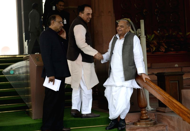 BJP leader Subramanian Swamy and Samajwadi Party chief Mulayam Singh  at the Parliament House in New Delhi, on Dec 8, 2015. - Mulayam Singh