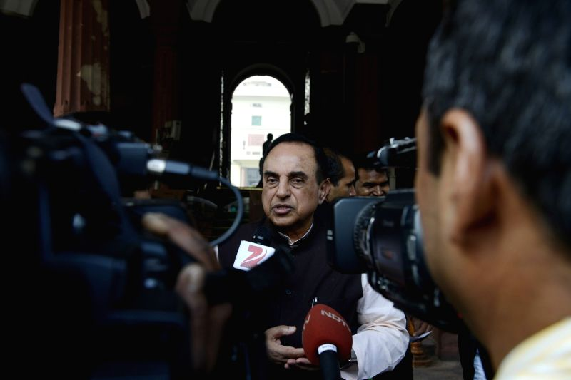BJP leader Subramanian Swamy talks to press at the Parliament House in New Delhi, on Dec 8, 2015.