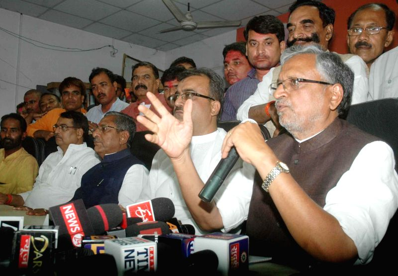 BJP leader Sushil Kumar Modi  addresses a press conference regarding party's performance in the state during 2014 Lok sabha Elections, in Patna on May 16, 2014. - Sushil Kumar Modi