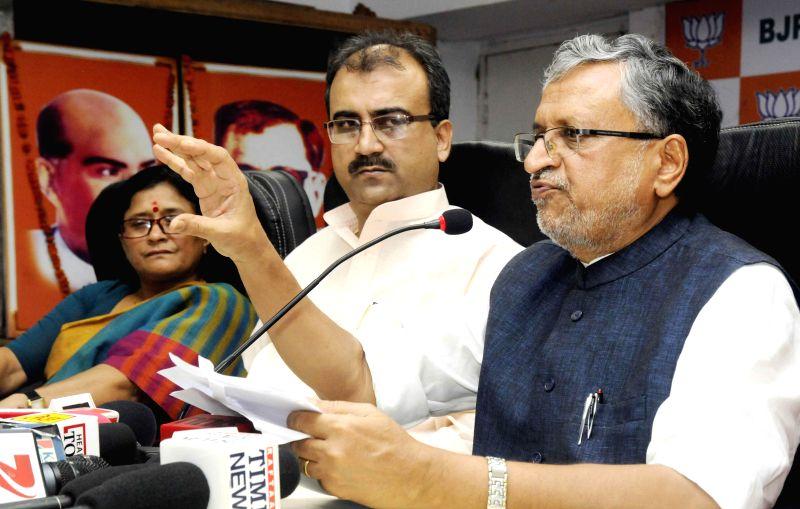 BJP leader Sushil Kumar Modi addresses a press conference in Patna on Aug 5, 2014. - Sushil Kumar Modi