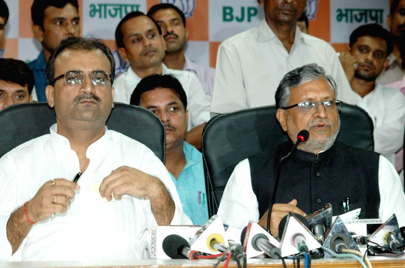 BJP leader Sushil Kumar Modi addresses a press conference in Patna on Aug 25, 2014. - Sushil Kumar Modi