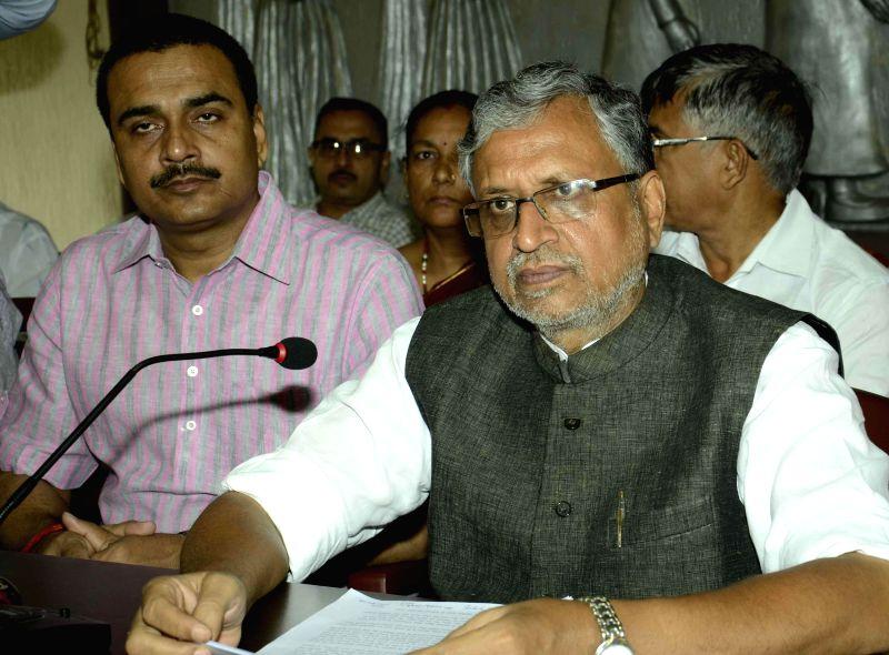 BJP leader Sushil Kumar Modi addresses a press conference in Patna on Sept 2, 2014. - Sushil Kumar Modi