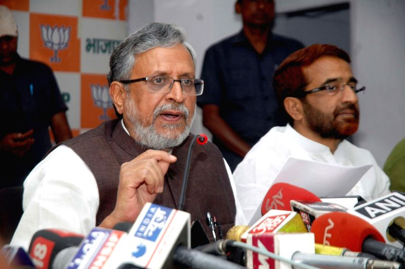 BJP leader Sushil Kumar Modi addresses a press conference in Patna on April 27, 2017. - Sushil Kumar Modi