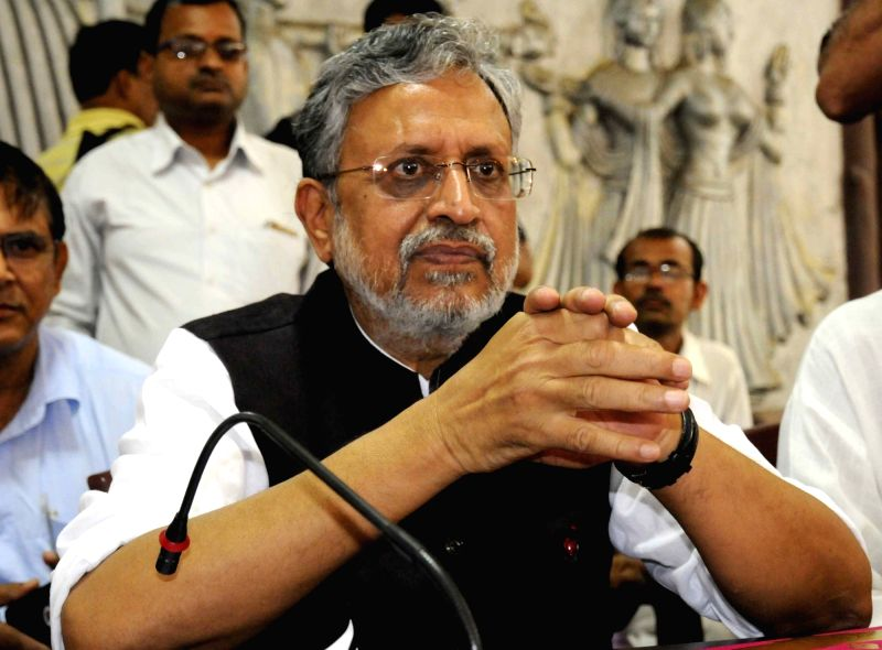 BJP leader Sushil Kumar Modi addresses a press conference in Patna on May 16, 2017. - Sushil Kumar Modi