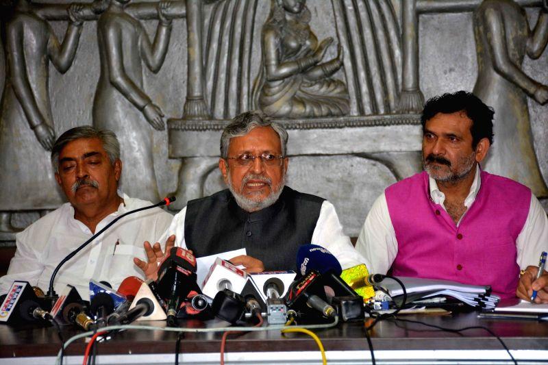 BJP leader Sushil Kumar Modi addresses a press conference in Patna on May 30, 2017. - Sushil Kumar Modi