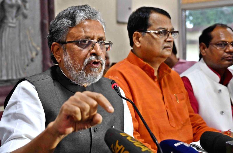 BJP leader Sushil Kumar Modi addresses a press conference in Patna, on July 11, 2017. - Sushil Kumar Modi