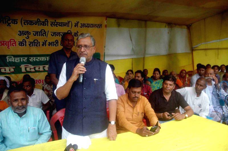 BJP leader Sushil Kumar Modi addresses during a rally in Patna on July 28, 2016. - Sushil Kumar Modi