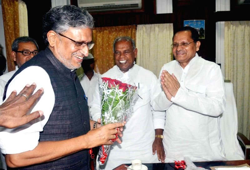 BJP leader Sushil Kumar Modi arrives at Bihar Legislative Council in Patna on June 27, 2014. - Sushil Kumar Modi