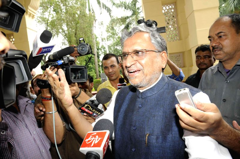 BJP leader Sushil Kumar Modi arrives to attend the Monsoon Session of Bihar Legislative Council in Patna on July 9, 2014.