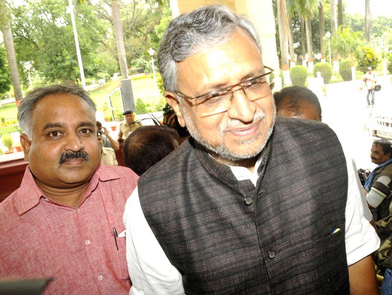 BJP leader Sushil Kumar Modi arrives to attend the Monsoon Session of Bihar Legislative Council in Patna on July 15, 2014.