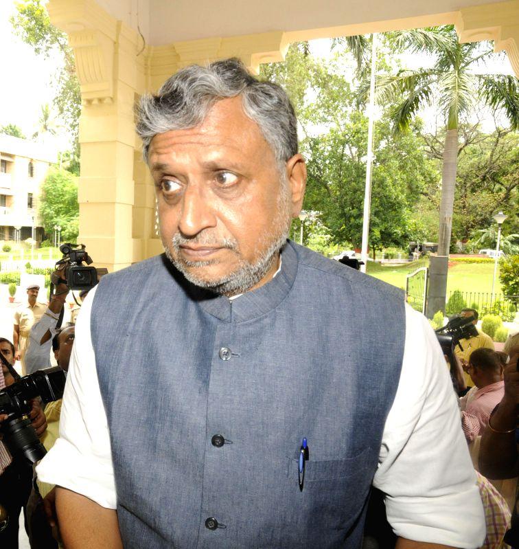BJP leader Sushil Kumar Modi arrives to attend the Monsoon Session of Bihar Legislative Council in Patna on July 17, 2014.