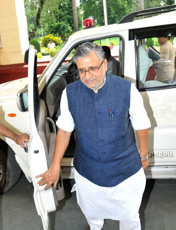 BJP leader Sushil Kumar Modi arrives to attend the Monsoon Session of Bihar Legislative Council in Patna on August 1, 2014.
