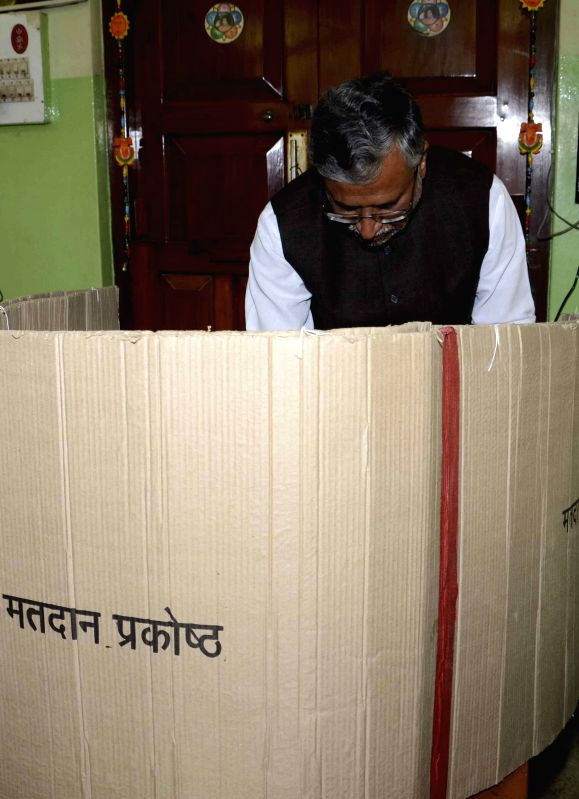 BJP leader Sushil Kumar Modi casts his vote during the fifth phase of 2014 Lok Sabha Polls in Patna on April 17, 2014.