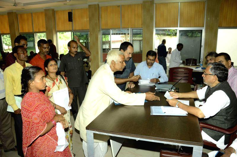 BJP leader Sushil Kumar Modi during Janata Durbar in Patna on Sept 2, 2014. - Sushil Kumar Modi