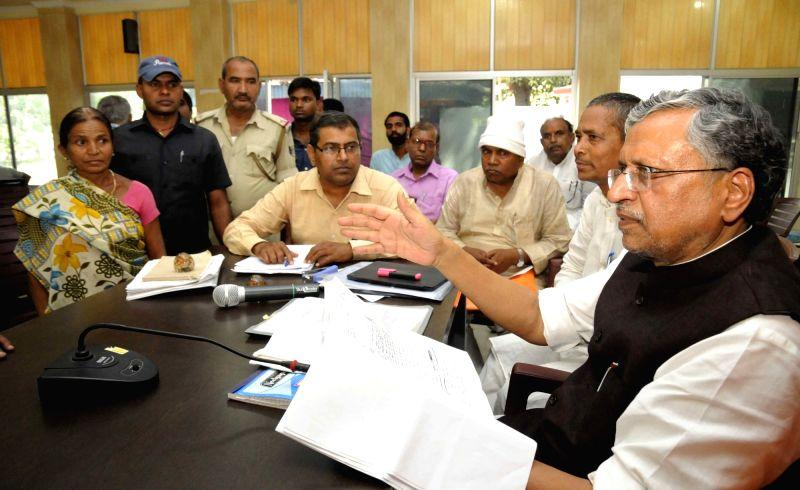 BJP leader Sushil Kumar Modi interacts with people in Patna on April 5, 2016. - Sushil Kumar Modi