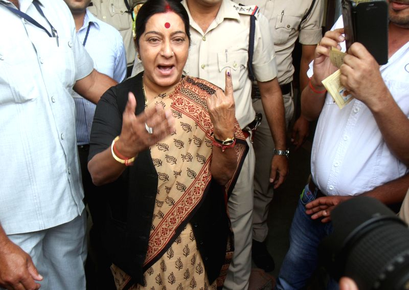 BJP leader Sushma Swaraj shows her fore finger marked with phosphoric ink after casting her vote during the fifth phase of 2014 Lok Sabha Polls in Bhopal on April 17, 2014.