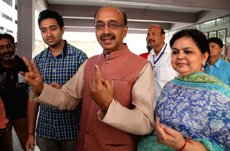 BJP leader Vijay Goel shows his fore finger marked with phosphoric ink after casting his vote during the third phase of 2014 Lok Sabha Polls in New Delhi on April 10, 2014. Elections are being held ..