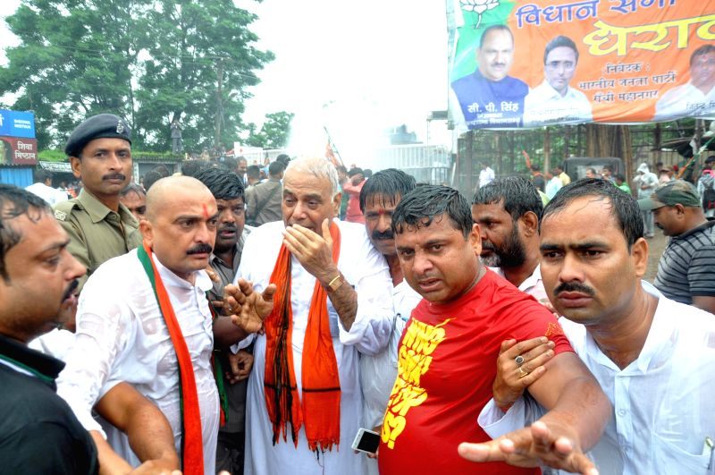 BJP leader Yashwant Sinha gets drenched as police charges water cannons on BJP workers trying to gherao Jharkhand Assembly in Ranchi on Aug 5, 2014. - Yashwant Sinha