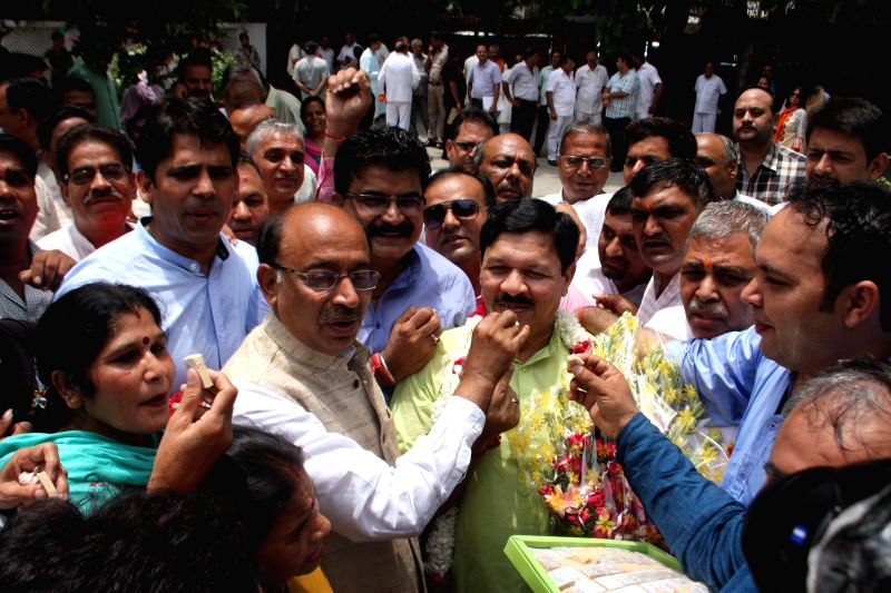 BJP leaders and supporters of the newly appointed National Vice President Shyam Jaju as Delhi BJP in-charge celebrates in New Delhi on July 4, 2015.