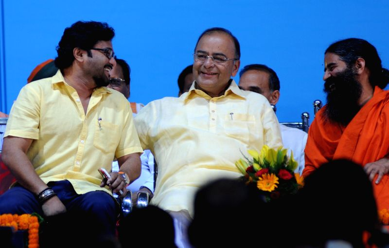 BJP leaders Arun Jaitley and singer turned politician Babul Supriyo with Yoga guru Ramdev during Sankalp Purty Mahotsav organised by Bharat Swabhiman Trust in New Delhi on May 18, 2014. - Arun Jaitley