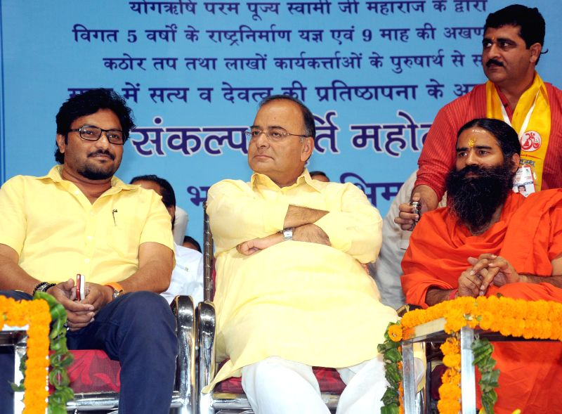 BJP leaders Arun Jaitley and singer turned politician Babul Supriyo with Yoga guru Ramdev during Sankalp Purty Mahotsav organised by Bharat Swabhiman Trust in New Delhi on May 18, 2014. - Arun Jaitley