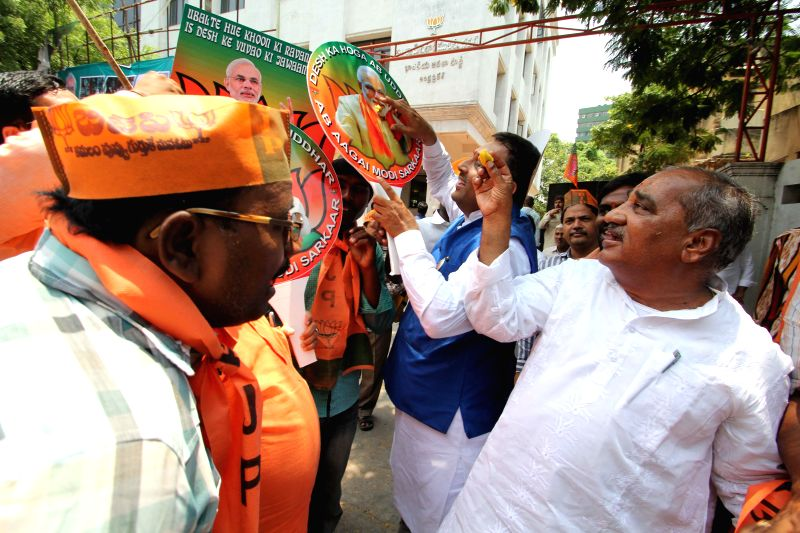 BJP leaders celebrate as counting for 2014 Lok Sabha Election is underway and the party is leading nationally, in Hyderabad on May 16, 2014.