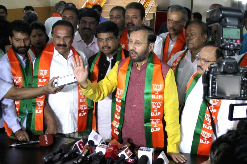 BJP leaders D. V. Sadananda Gowda, Dharmendra Pradhan, Prakash Javadekar and J.P. Nadda address a press conference, at the party office in Bengaluru on May 16, 2018.