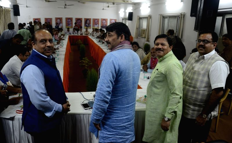 BJP leaders Manoj Tiwari and Vijay Goel during a party meeting in New Delhi on May 22, 2017.
