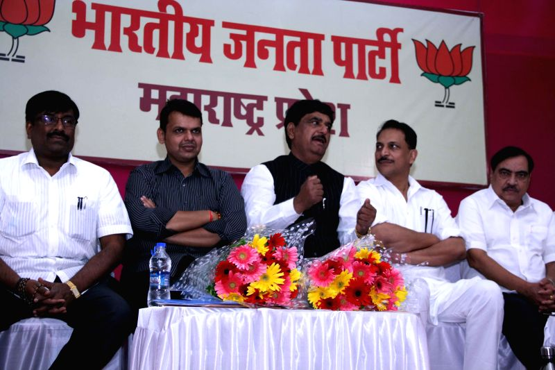 BJP leaders Rajiv Pratap Rudy, Gopinath Munde and others during a party meeting in Mumbai on May 14, 2014.