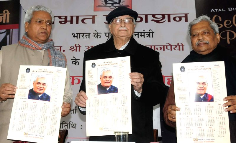 BJP leaders Ram Lal (R) and Prabhat Jha (L) with BJP veteran and party MP from Gandhinagar L K Advani at the launch of `Hamare Atal ji` - a book edited by Jha on former prime minister Atal Behari ...