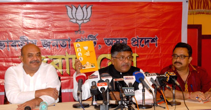 BJP leaders Ravi Shankar Prasad and Sudhanshu Mittal during a press conference in Guwahati on April 20, 2014.