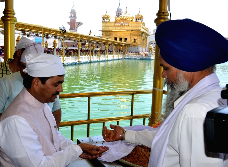 BJP leaders Syed Shahnawaz Hussain pays obeisance at the Golden Temple in Amritsar on April 27, 2014.