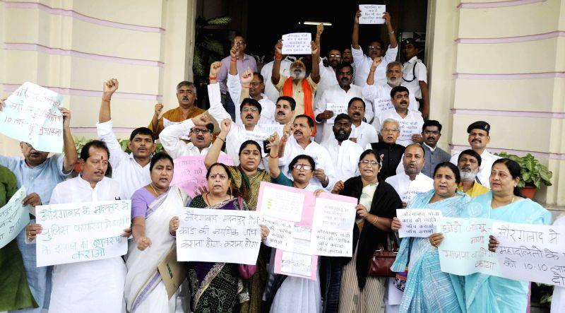 BJP legislators demonstrate against Aurangabad firing at Bihar Legislative Assembly premises in Patna on July 21, 2014.