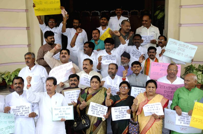BJP legislators demonstrate against lathicharge on teachers at Bihar Assembly on July 16, 2014.