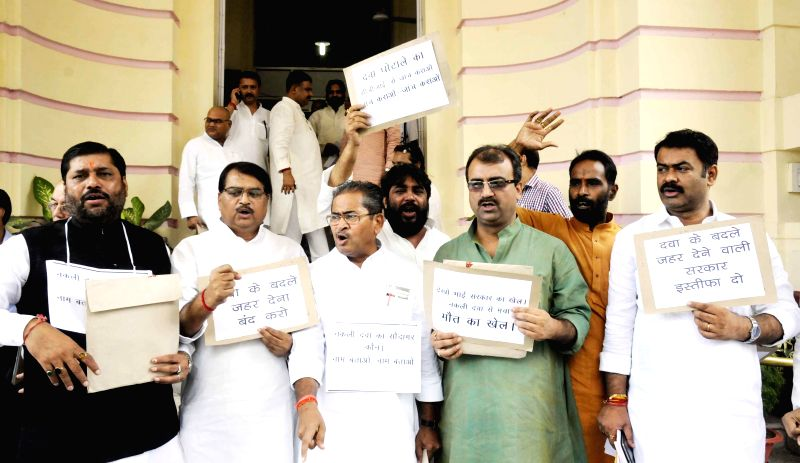 BJP legislators demonstrate against Medicine scam at Bihar Legislative Assembly in Patna on July 7, 2014.