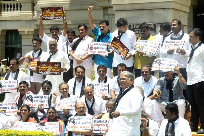 BJP legislators demonstrate to press for security of women, at Vidhana Soudha in Bangalore on July 18, 2014.