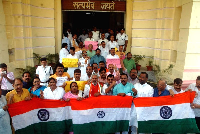 BJP legislators stage a demonstration against insult of the Indian national flag at Bihar Assembly in Patna on Aug 3, 2016.