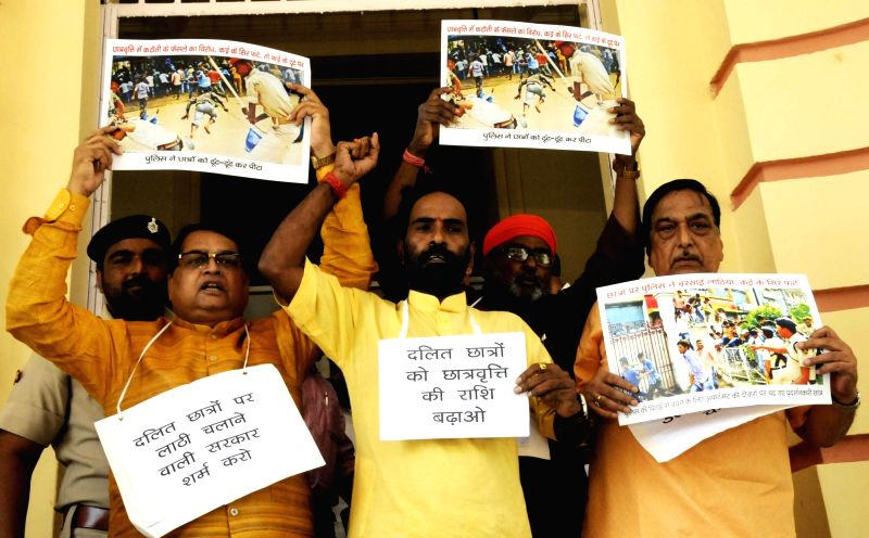 BJP legislators stage a demonstration at the Bihar Assembly in Patna on Aug 4, 2016.