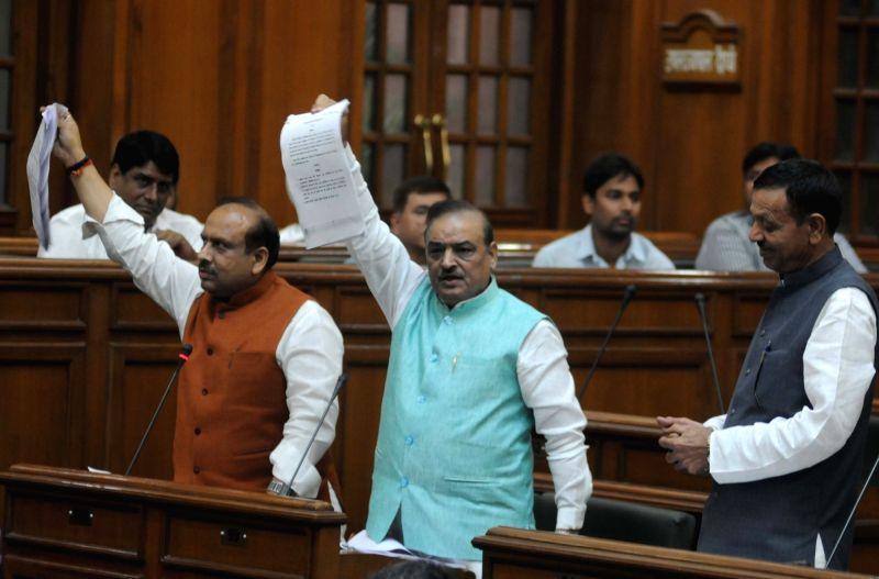 BJP legislators Vijender Gupta and Jagdish Pradhan stage a demonstration on Day-1 of Delhi Assembly`s winter session, in New Delhi on Nov 18, 2015. - Vijender Gupta